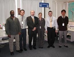 WMO Secretary-General visits         the WPC International Desks - August 5, 2003