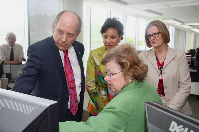 NWS Director Louis Uccellini (left), Commerce Secretary Penny Pritzker, Acting NOAA Administrator Dr. Kathryn Sullivan , and Senator Barbara Mikulski (MD) view potential improvements in storm surge forecasts.
